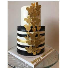 Black white and gold Mickey Mouse anniversary cake