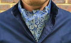 Woven Silk Day Cravat (Ascot Tie)Navy with Electric Yellow & Cerulean Frost Dragon-Themed PaisleyMade From Grade A1 Mulberry Silk100% Pure Silk • Dry Clean OnlyWoven and Handcrafted in England Dimensions: Tip to Tip 120cm, Width of Blade 15cm,...