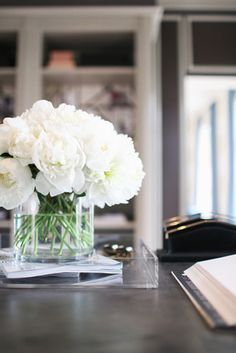 white peonies in a glass tank and acrylic tray//