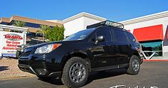 Pictures and description of a 2015 Subaru Forester Black. Method Race Wheels, BFGoodrich, Primitive Racing Leveling Kit.