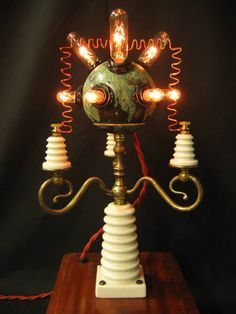 A nice way of recycling old ceramic electric insulators. Steampunk Tendencies