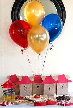 Paddington Bear Birthday Party: Adorable Paddington gift bags and balloons. Simple, easy party decor! Don't forget to watch the Paddington movie on January 16, 2015! Thanks for sharing these creative ideas, @makeandtakes!