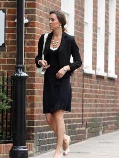 Kate hustling and bustling through London Town.