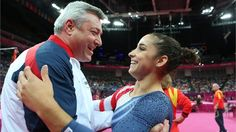 Alexandra Raisman of the United States hugs coach Mihai Brestyan - Beam Final - London 2012
