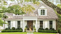 """Flattening the entrance's peaked roof and expanding it into a real porch was the key to creating a """"distinct entry for the home,"""" says architect Corbett Scott. The n"""
