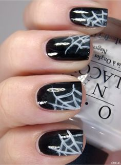 Halloween nails spider webs. Cute and easy! Would be cute as an accent nail, with orange, or purple sparkles.