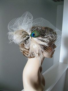 pretty peacock birdcage veil with dyed peacock feathers