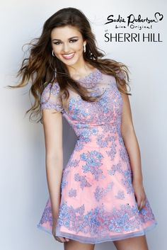 What a nice combo of colors for a dress, pink and blue!                                                                                                                                                                                 More