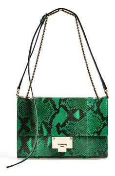 This gorgeous Jimmy Choo statement purse in emerald green adds luxe-sophistication to any street-chic ensemble.