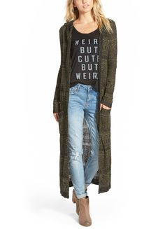 A trendy geometric design patterns this long, hooded cardigan that would make a perfect cool-weather layering piece.