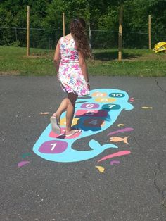 Dolphin Hopscotch- Take a dip in the water and swim with this playful dolphin. Hop from space to space using a marker to toss and collect. Hopscotch games strengthen balance and endurance and the use of numbers reinforces mathematical skills. Marker, Picnic Blanket, Outdoor Blanket, Summer Fest, Bronze Award, Outdoor Play Spaces, Hopscotch, Forest School, School Decorations