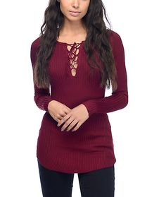 Get ready for sweater weather with the Charlie burgundy lace up sweater from Almost Famous. This slim fit bodycon sweater is made from stretchy ribbed knit fabric and is accented by a lace up front for a fierce look.
