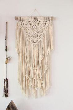 This Macramé Wall Hanging is made with 100% biodegradable cotton twine in off white and 1 piece of driftwood from the Atlantic Ocean found in NB, Canada. It measures: 11.5 wide x 27 long Local Orders: use coupon code LOCALshopper22 to remove shipping fee and message me to arrange pick up
