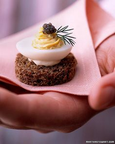 Wedding Cocktail-Hour Recipes: Deviled Quail Eggs - Only a quail egg is tiny enough to fit atop this canape. It is deviled, dressed with caviar and dill, and affixed to a round of pumpernickel with a silky mixture of creme fraiche and Dijon mustard.