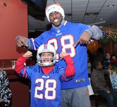 C.J. Spiller with his biggest fan!