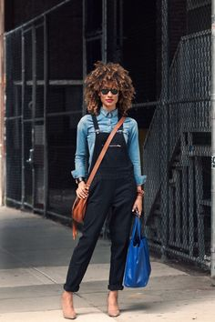 If you want a truly unique look, then wear your black overalls with a denim/chambray shirt. You will surely turn heads with this combination.  Read more: http://glamradar.com/what-to-wear-with-overalls/#ixzz3dR2cr17g