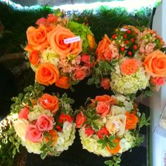 The orange colors of these bouquets remind me of a crisp October evening