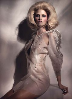 See Lara Stone try on all the most glamorous evening gowns on wmag.com.