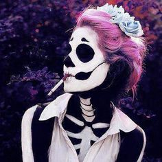 Pink and purple haired skeleton smoking. How much better can this get?!?! Lol