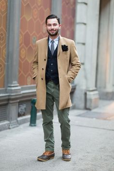 This smart pairing of a camel overcoat and olive chinos is very easy to pull together in next to no time, helping you look dapper and ready for anything without spending too much time going through your wardrobe. Add a pair of charcoal leather casual Mens Wardrobe Essentials, Men's Wardrobe, Street Style Trends, Olive Chinos, Peacoat Outfit, Pants Outfit, Grey Leather Boots, Leather Gloves, Men Stuff