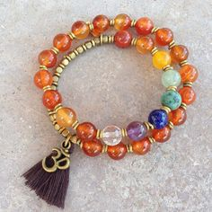 Colorful and balancing, smooth carnelian to concentrate on the second chakra, and chakra gemstones, 27 bead wrap bracelet with hand made brass African Trade Beads (for sizing),and an Om charm to evoke