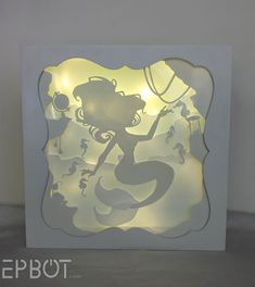 This Little Mermiad Papercutting Lights Up! AND IT'S SO PRETTY.