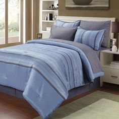Change the look of your bed in one fell swoop with this traditional eight-piece bedding set. This handsome ensemble includes everything you need to outfit your bed from head to toe, and the materials used ensure comfort and long-lasting use.