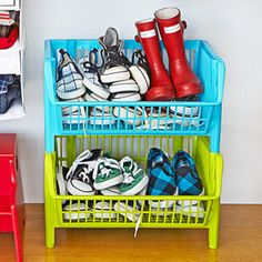 Get kid's shoes off the floor in these plastic stackable baskets. $ 6 each from containerstore.com.  Buy plastic stackable baskets at containerstore.com