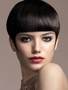 Blunt cut edgy short hair with straight across bangs.