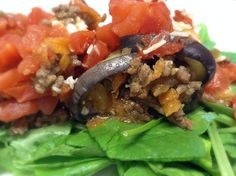 DINNER:  eggplant beef roll-ups w/ feta cheese, shredded sweet potatoes, carrots, onions & stewed tomatoes.  Served on a bed of fresh spinach!  :).