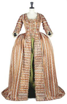 Sack back French open robe of apricot silk, originally made up as a wedding gown, c. 1775.