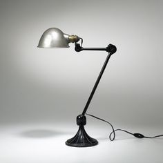 Ravel adjustable lamp, model, France,c.1920, cast iron, enameled metal 14 w x 8 d x 22 h inches. Ravel lamps, known as Grass lamps, were among the earliest articulated lamp designs.