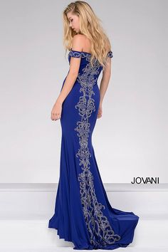 Gorgeous royal floor length and form fitting jersey dress with crystal beading on the bodice and a waterfall back features off the shoulder sweetheart neckline, also available in black, red and white.