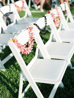 Leis for every guest on white garden style chair. Simple way to dress up an already beautiful chair. #exporentals #weddings #gardenstylechair