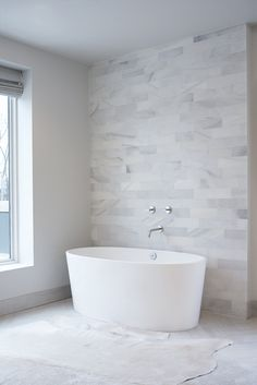Leo Designs Chicago - bathrooms - marble clad wall, marble accent wall, linear marble tiles, full marble wall, herringbone floor, white herr...