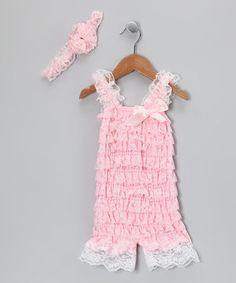 Slip a stylish sweetie into some thrilling frills. Featuring a romper outfitted with rows of lace ruffles and sweet hues plus a matching flower headband, this stretchy set will instantly make any little angel look downright darling.