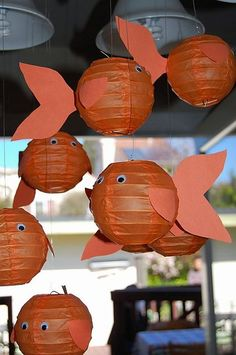 Make fish from paper lanterns and hang at various lengths from the ceiling.