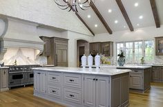 Country Kitchen with Chandelier, Global views grande urn with lid white, Multiple islands, Flat panel cabinets, Raised panel