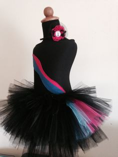Wyldstyle is here!! It can be used for a birthday, halloween or any dress up event! This costume is made to order. Shown in size 4T/5T. The bodice is