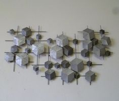 3D metalen wanddecoratie EOS - ABSTRACT - WANDDECORATIE METAAL | DEKOGIFTS Wall Decor, Wall Art, Stud Earrings, Abstract, Table, Furniture, Home Decor, Decoration, Abstract Shapes