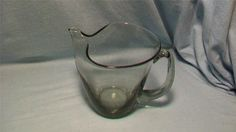 Asking: $70./ 7.35   Squat Erickson Smoke Martini Pitcher | eBay.  5.5 inches tall and 7 inches wide including the handle.