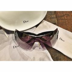 """‼️FLASH SALE‼️Authentic Dior Airspeed sunglasses Used authentic Christian Dior sunglasses but in very good condition. Some minor scratches on the lens. (Please see pictures). They have a big D on each side. The """"Christian Dior"""" copyright engraving on the inside. They have almost a purple-ish tint to them. They come with their original hard case, a soft sunglass holder and a towel which are a little dirty but can easily be cleaned! **My entire closet is 100% authentic. No fakes here :)…"""