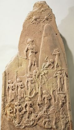 "Victory stele of Naram-Sin, from Susa, Iran, 2254–2218 BCE. Pink sandstone, 6' 7"" high. Louvre, Paris."