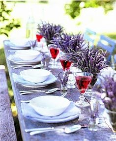 Lavender...So Beautiful ~ I have so much lavender in my garden, but never thought of using it for table decor. This gorgeous image makes me want to stain a rustic picnic bench in a lilac hue...