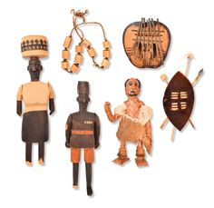 Selkirk Auctioneers  COLLECTION OF MADE FOR MARKET AFRICAN ARTICLES.  Various African countries. Various human figures as well as necklace and a seal skinned shield.  Estimate $ 75-150