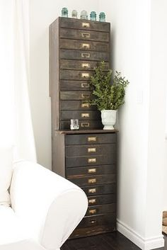 love this cabinet!  Oh, my goodness!  How many little trinkets could you hide in all of these drawers?