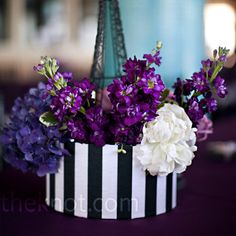 black and white hat box, filled w/white and purple blooms, surrounded by a mini Eiffel Tower