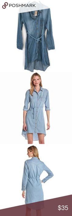 NWT Levis Denim Shirt Dress NWT Levis denim shirt dress with hi-low hem and rope tie waist. Stock photo is a little bit of a lighter wash but shows how the dress fits. Size XL, fits a little on the small side, so might be better for large. Levi's Dresses High Low