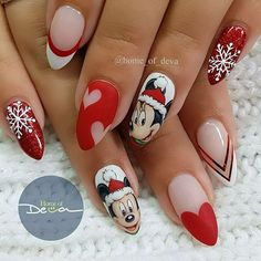 Matte Christmas red oval nails with cute Mickey Mouse design, hearts and snowflakes! It is almost Mickey's 89th birthday! So, here is a post of all the Mickey and Minnie nails hand painted by Ugly Duckling Exclusive Ambassadors and family members @home_of_deva  Ugly Duckling Nails page is dedicated to promoting quality,
