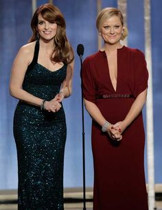 """Tina Fey: """"'The Hunger Games' isn't just a movie. It's what I call the six weeks it took me to get into this dress."""" Amy Poehler: """"Ang Lee's been nominated for 'Life of Pi' which is what I'm going to call the six weeks after I take this dress off!""""    Photographer: Getty Images"""